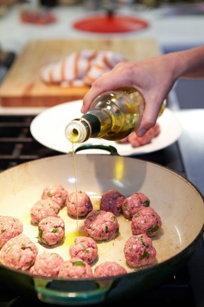 Great Grandma Turano's Meatballs with homemade tomato sauce and pasta.
