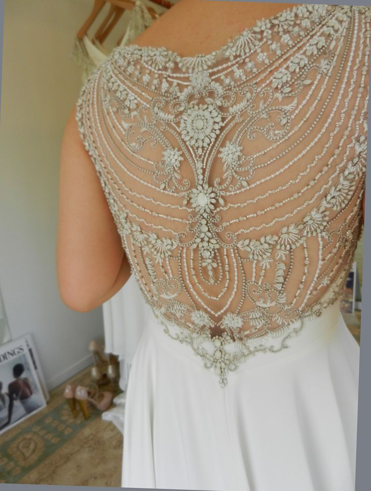 Gorgeous white beaded low back on this real bride's wedding dress. See more: annaschimmel.co.nz