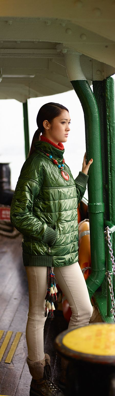 Show off your feel for luxe, regardless of whether you are on and about town or skiing in St. Moritz. This super-cosy quilted down jacket in glossy nylon will do nicely, while the asymmetric stand-up collar adds just the right pinch of drama.