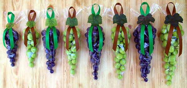 Wine tasting party favors.  I don't know about the different sizes but what a cute idea!