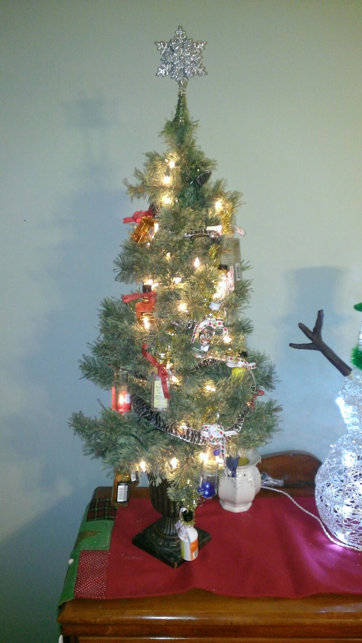 Mini Liquor Christmas tree....have a Christmas Party to decorate it then a New Year's party to drink it!