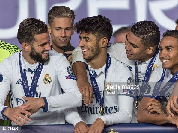 News Photo : Real Madrid players Nacho, Marcos Llorente, Marco...