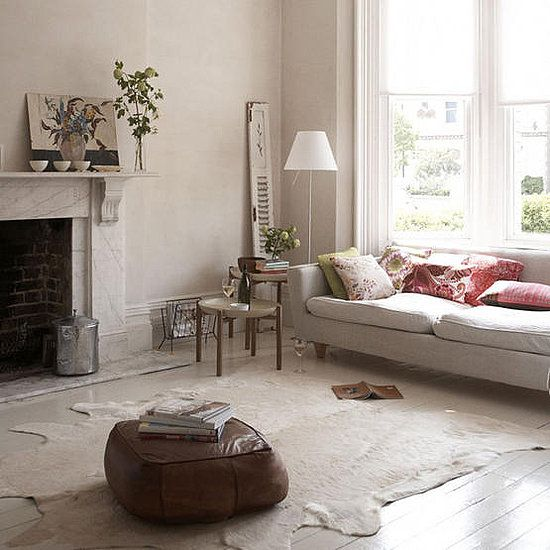 10 ideas for decorating with cowhide rugs a well grey for Cowhide decorating ideas