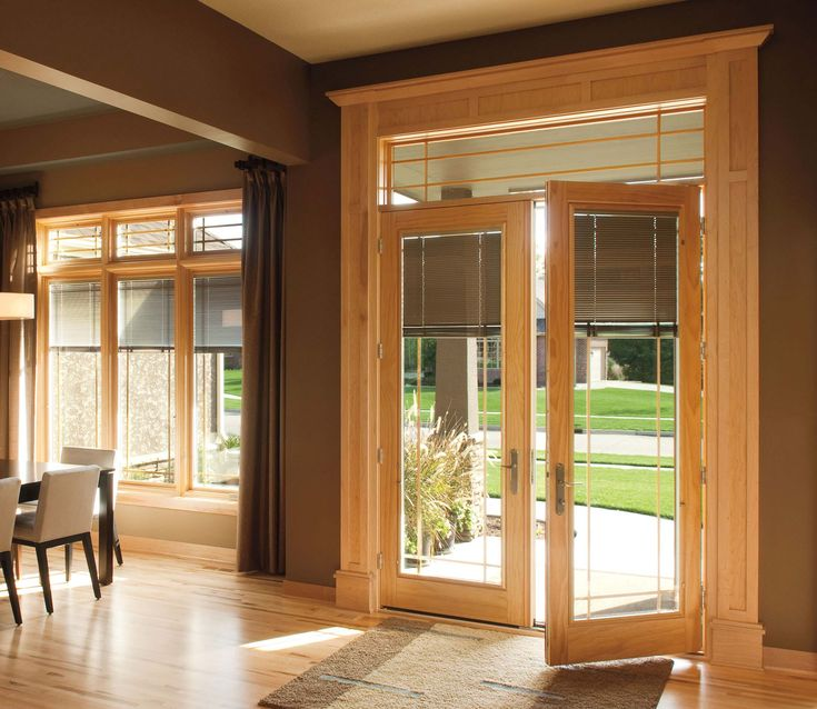 Pella Designer Series hinged patio doors offer innovative between-the-glass blinds, shades, decorative panels and grilles that can be easily changed to express your style.