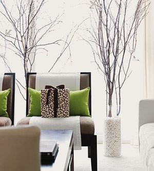 The winter branches could go beyond Christmas. So pretty in a living room window space!