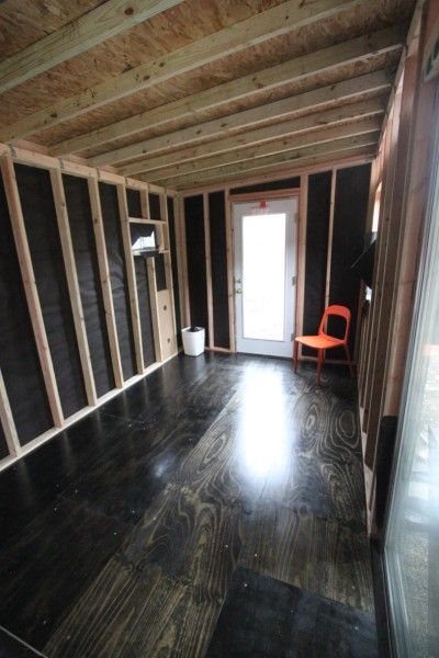 Pine ply wood laid over a 5/8 inch sub floor, stained, and sealed for a flooring alternative.