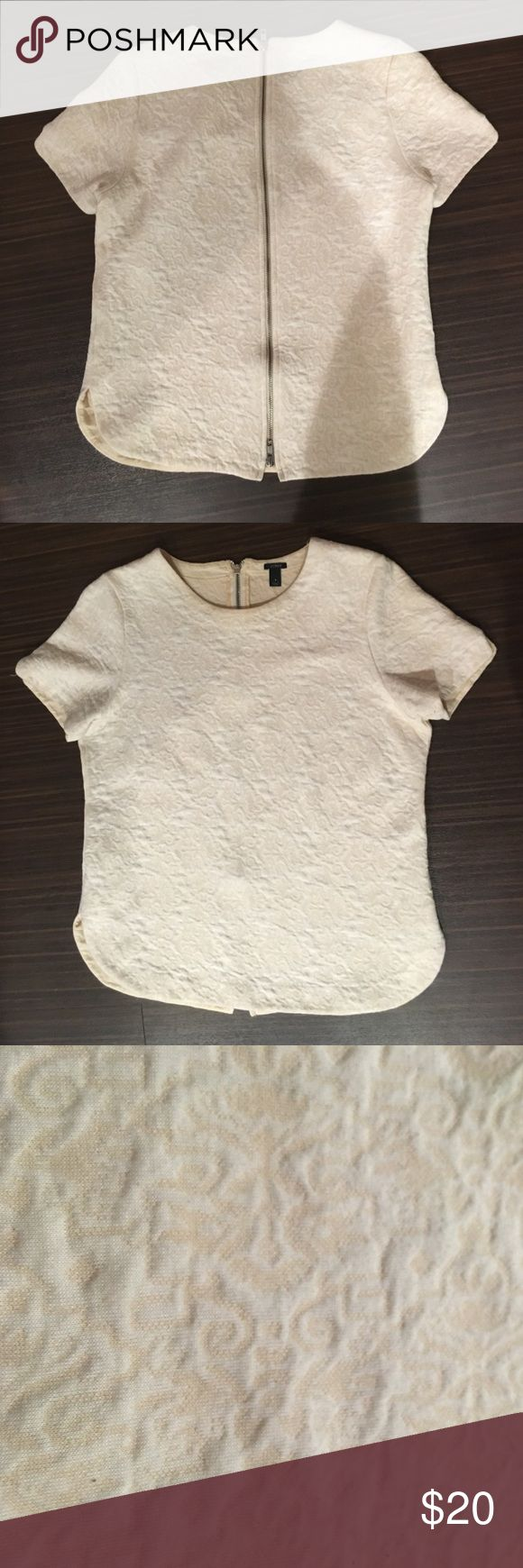 J. Crew cream short-sleeved top with zip-up back J. Crew cream short-sleeved top with silver zipper up the back. Lace-like print. This is a lightweight sweatshirt fabric with rounded hem. Size small. 80% cotton. 20% polyester. J. Crew Tops