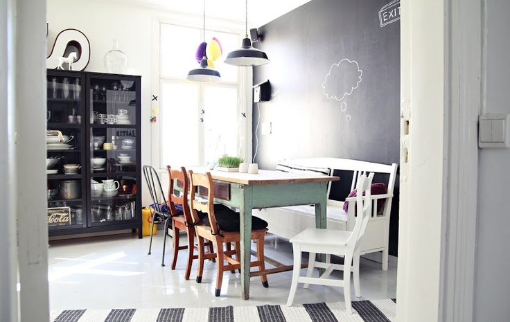 Antique kitchen table & chairs. 1920s white bench. Ikea black cupboard. Vintage lamps from Paris. Chalkboard paint.