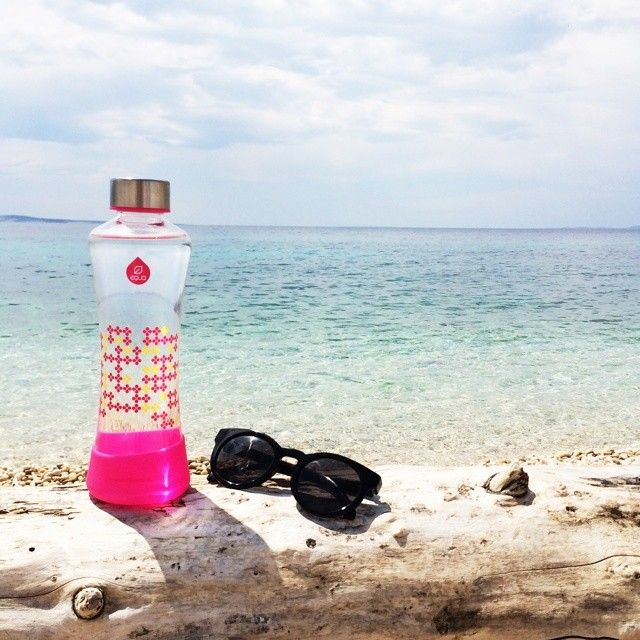 Already dreaming of your summer escape? emoji Wherever you go, whatever you do, don't forget to take your water bottle with you. We can't stress enough how important adequate hydration is for your well-being emoji #cantwaitforsummer emoji #beachlife #equa #myequa #waterbottle #glassbottle #hydration #fun #sweet #joy