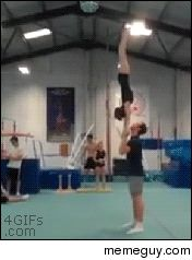 This is pretty amazing but is anyone seeing the girl and guy on the left. One arm handstand in his head while he sits then he stands up!