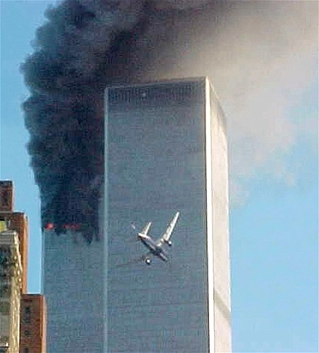 As the north tower of the World Trade center burns in the background, United Airlines Flight 175 is lined up to strike the south tower at 9:03 a.m. on Sept. 11, 2001. Terrorists took over that flight and also American Airlines Flight 11, crashing the planes into the twin towers.