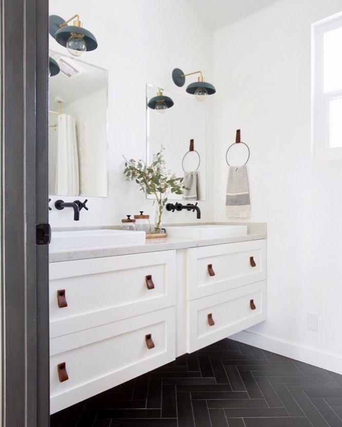 Matte Black Herringbone Floors Cedarandmoss Light Fixtures Leather Cabinet Pulls And A Floating Vanit Floating Vanity Ikea Vanity Bathroom Cabinets Designs