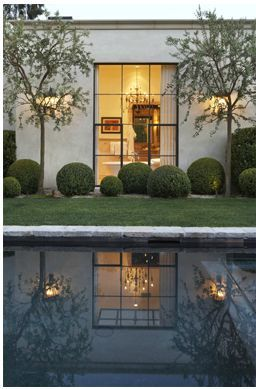 exterior, attributed to Scott Shrader. I love the asymmetrical placement of the boxwoods, and the way in which the trees and steel window reflect in the pool.Top pinned images of January 2014