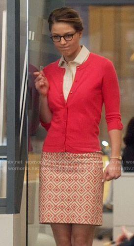 Kara's geometric print skirt and red cardigan on Supergirl