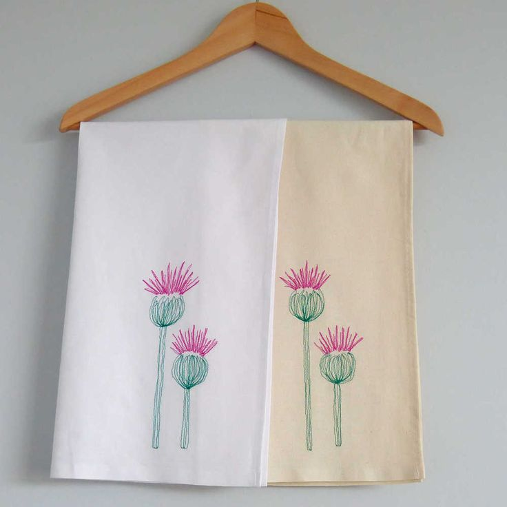 The iconic Scottish Thistle. 100% Cotton Tea Towel. Natural or White Cotton, with Dusty Thistle Pink and Pine Needle Green coloured threads depicting two big, jaggy, Scottish thistles. Due to our freehand technique, as in nature, no two thistles are exact...