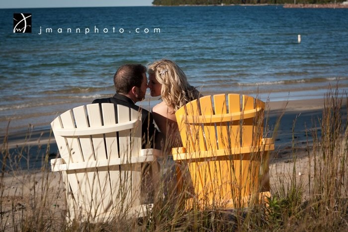 Bride & Groom on the beach near Baileys Harbor, Door County, WI.    (mike and i have pictures like this already!)