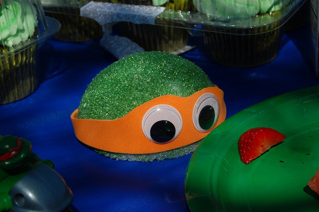 Teenage Mutant Ninja Turtle - TMNT birthday party decoration. Cut styrofoam balls in half, paint with green glitter paint. Cut masks from foam sheets and glue on googley eyes. Once paint is dry, glue mask to head.