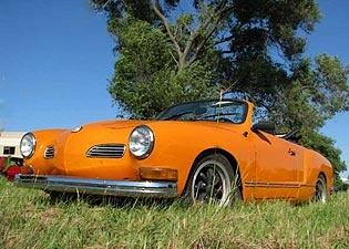 Be still my beating heart! An orange Karmann Ghia convertible!  Love you!