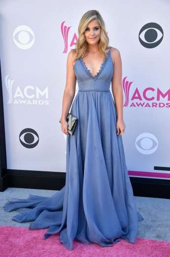 Hits and Misses:     Lauren Alaina's beautiful dusky blue gown with triangle notch detailing at the neckline fit her like a glove -- we just wish she'd made more of an effort with her hair!