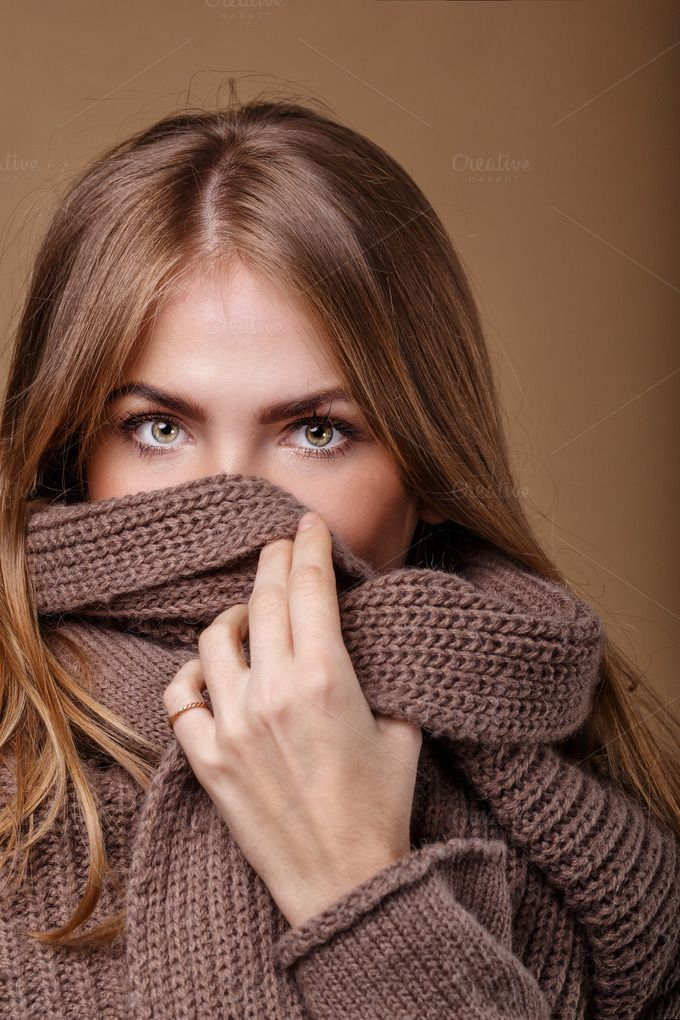 Girl hide face in warm sweater by Elena Vagengeim on Creative Market