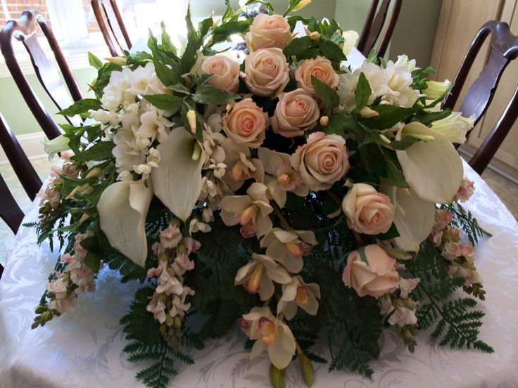 This was a very special order. The silks Were from A&B Floral in Charlotte, NC. Pale pink roses, white orchids,greenery, White Calla Lilies, Bells of Ireland.