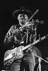 """Clarence 'Gatemouth' Brown, Guitarist and violinist from Vinton, LA, Brown was born on this day in 1924.  He played all genres of music, but is predominantly known for his blues playing. He was raised in Orange, TX and influenced by the great T-Bone Walker. In 1981, he recorded """"Alright Again"""" which earned him a Grammy Award. He recorded and performed regularly until his death in 2005 after evacuating his Slidell home after Hurricane Katrina…"""