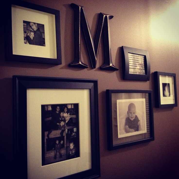 Cool Things To Put In A Basement: Black & White Photo Collage On Brown Wall