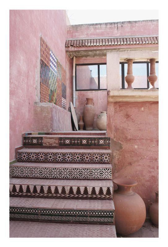 Moroccan, tiled steps, terra cotta pots, terrace
