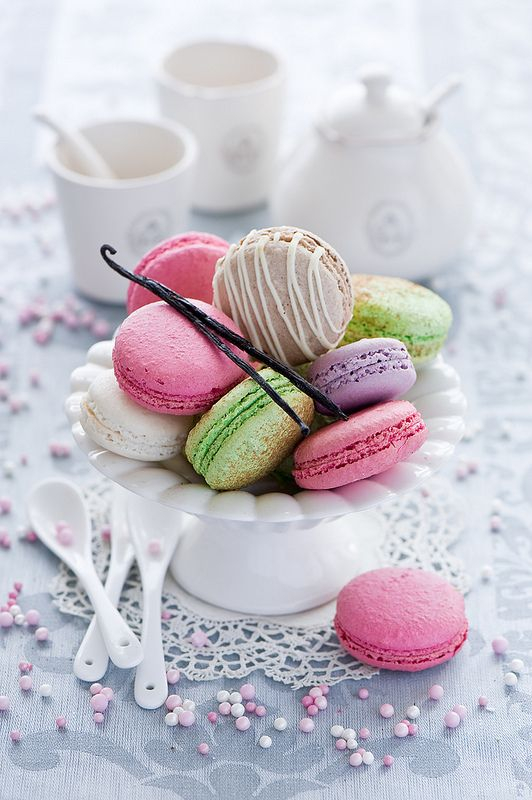 Different Flavoured Macarons. Delicious Desert. Strawberry. Lime. Pistachio. Vanilla. Coffee. Salted Caramel. Topped off with a Vanilla Bean.