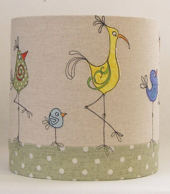 A quirky handmade drum lampshade, created with high quality linen and cotton fabrics, featuring a row of colourful cartoon birds marching around the base. I create each using high quality linen and cotton fabrics, embellished with applique and free-machine embroidery and signed with my machine embroidered signature. As each piece is individually made to order, no two will ever be the same. The lampshade is available in two sizes: 20cm diameter x 20cm h 30cm diameter x 20cm h If you requir...