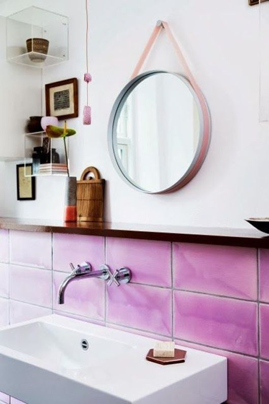Purple might be an interesting color choice for a bathroom, but they make it work!