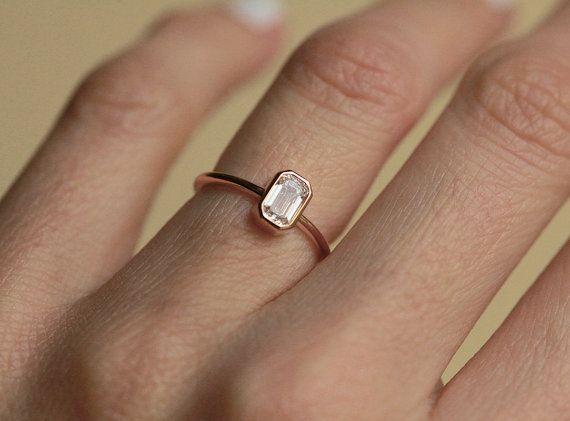 0.5 Carat emerald cut diamond ring with GIA certificate.  Gemstone: Diamond Gemstone Weight: 0.51ct with GIA certificate Gemstone Quality: Color E - F,