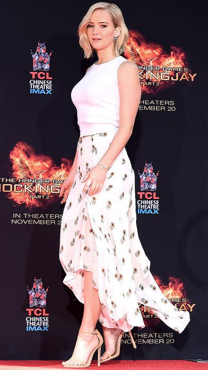 Jennifer Lawrence in a printed midi skirt, white top and nude heels