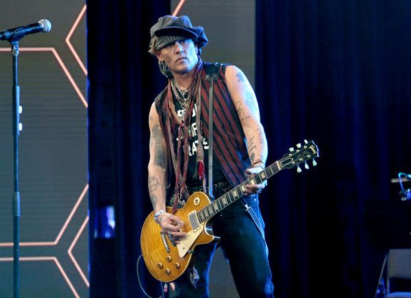 Johnny Depp Photos Photos - Actor Johnny Depp performs onstage at the TEC Awards during NAMM Show 2017 at the Anaheim Hilton on January 21, 2017 in Anaheim, California. - The NAMM Show 2017 - TEC Awards
