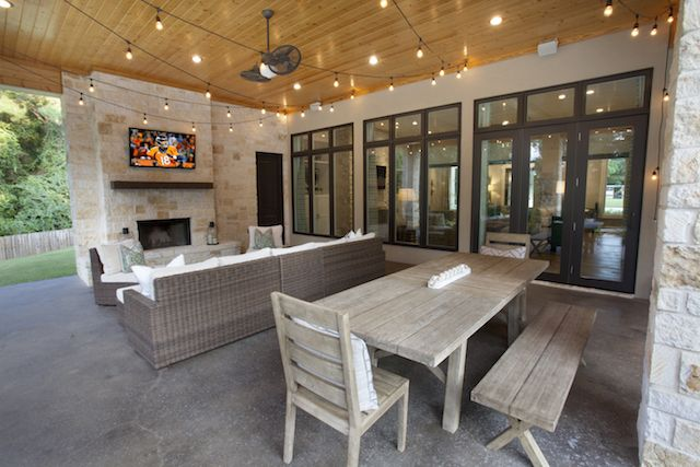 In Texas, there is time year-round for outdoor dining and festivities. This large covered patio space features ample sitting and eating spaces, with entertainment option! From Trent Williams Construction, Tyler, Texas
