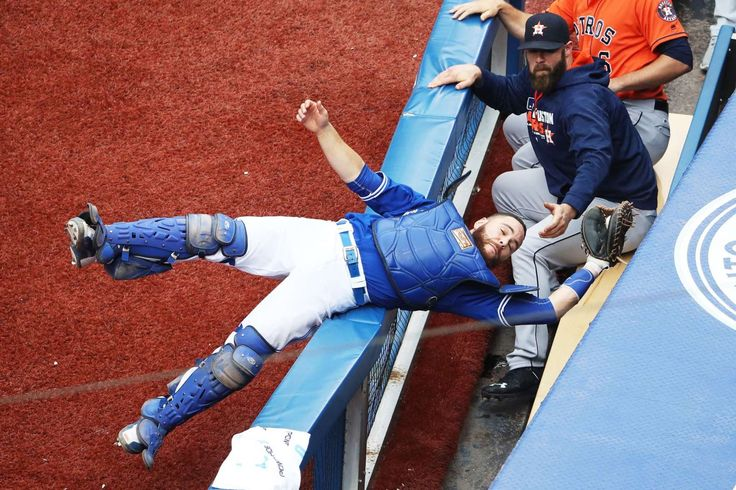 Not laying down on the job:    Russell Martin of the Toronto Blue Jays catches a foul pop up and avoids falling into the Houston Astros dugout during the seventh inning at Rogers Centre in Toronto on Aug. 14.