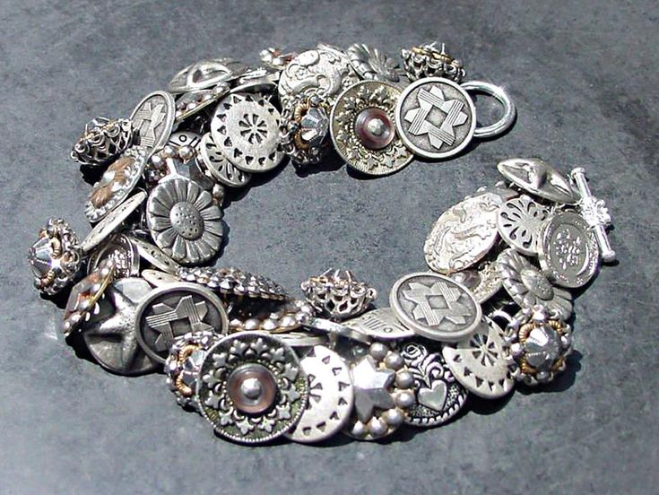 Vintage Button Bracelet Silver Metal and Pewter. $79.00, via Etsy.