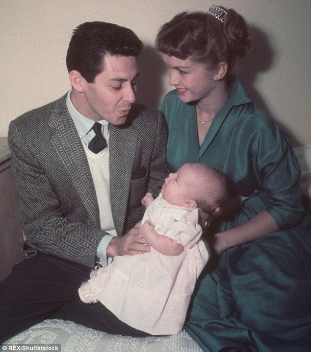 As a baby: Debbie and her singing husband Eddie with Carrie in 1956...