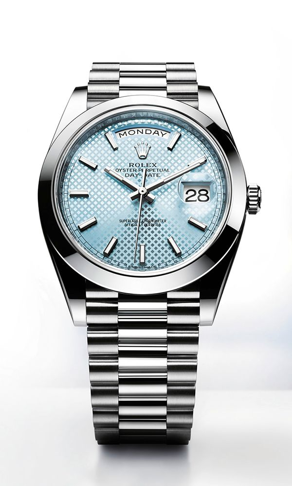 Rolex Day-Date 40 in 950 platinum, ice blue dial with diagonal motif and President bracelet.