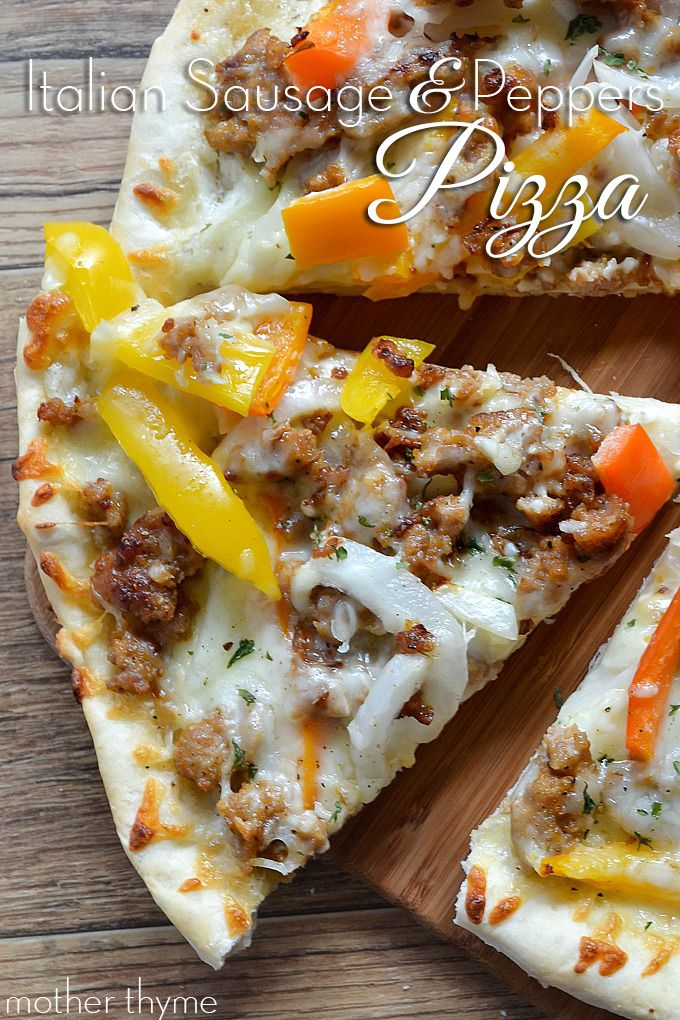 Make tonight pizza night with this Italian Sausage and Peppers Pizza with a homemade pizza crust, crumbled sausage, peppers and onions and a secret sauce.