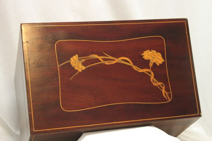 This is the lid on a lovely Edwardian ladies stationery. The box is veneered with mahogany with boxwood stringing and inlaid carnations. Superb. www.chinaroseantiques.com.au