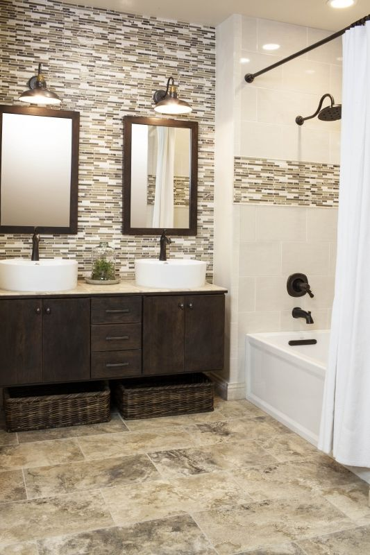 beautiful mosaic mix of coffee browns in marble travertine glass floating vanity with baskets underneath