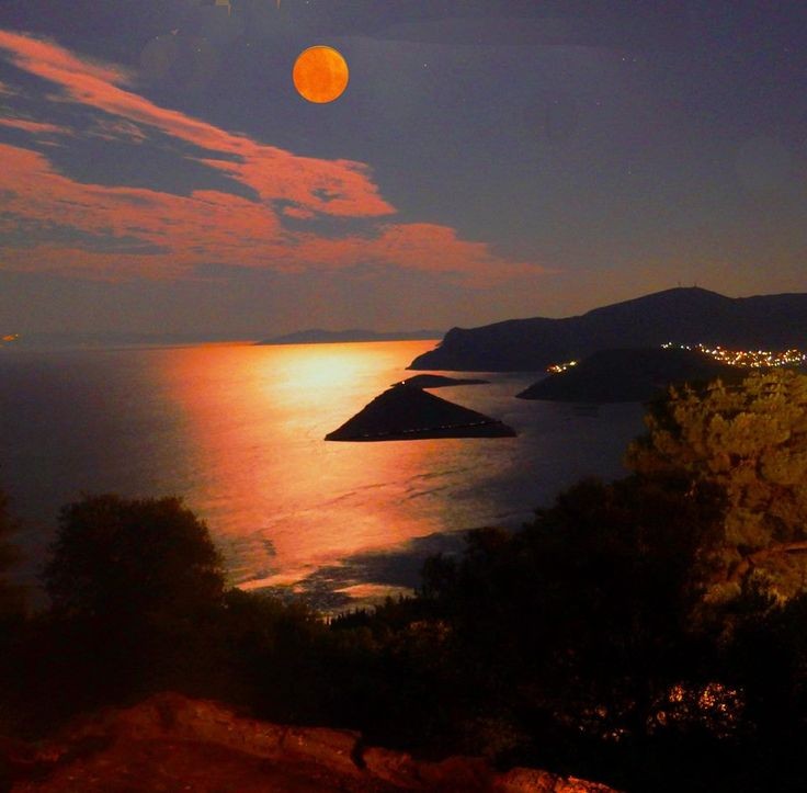Full moon over Porto Rafti, Greece, by George Seferlis