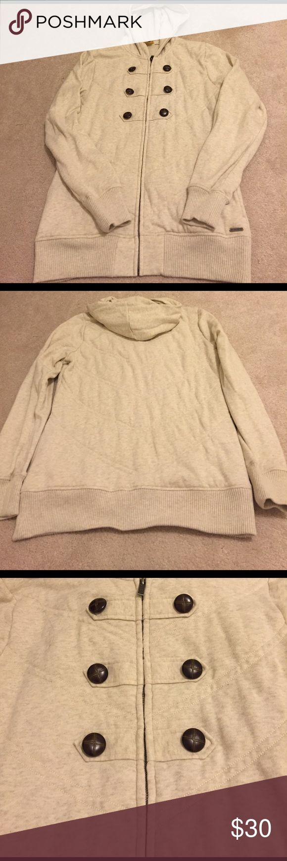 EUC Cream Heathered Zip Up Hooded Roxy Jacket. EUC Cream Heathered Zip Up Hooded Roxy Jacket. Cozy cream zip up hooded jacket. Faux buttons on the front. Side pockets. Only worn a few times. Washed on cold & hung up to dry. One small spot shown in the last picture. It's barely noticeable and blends in. No other flaws. No signs of wear. Size XL. Shell & lining consist of 60% Cotton & 40% Polyester. Comes from a pet free & smoke free home. No trades. Price reflects small spot. All proceeds…