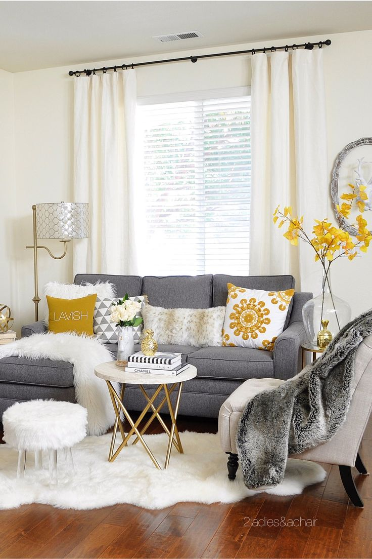 living room decor with grey couch grey white and yellow living room