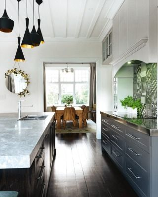 "ANITA MAES & HELEN WILCOCK – WHAT THE JUDGES SAID: ""An inviting family kitchen that integrates perfectly with the rest of this beautifully renovated home. Some really clever, interesting touches that are responses to the style of the home rather than just current trends. The simple curved mantel that hides the splashback, for example, and the detail in the cabinetry corner posts which echoes a similar emblem in wallpaper in the kitchen and elsewhere in the house."""