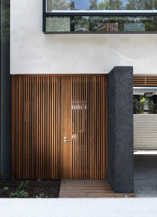 Elwood Townhouses / McAllister Alcock Architects wood entry door exterior facade