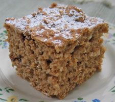 Low Fat Applesauce Cake: Nutrition Data Per Serving, 53 g: 67 calories, 13 g carbohydrate, 1 g fat, 129 mg sodium, 1 g dietary fiber, 1 g protein, low in Saturated Fat, and very low in Cholesterol, good source of Phosphorus and Manganese. Estimated gycemic load: 6