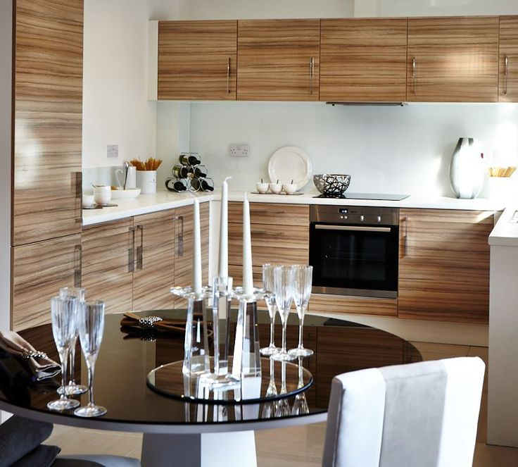 The kitchen dining area of the Ascona has French doors that lead onto the back garden. #Strata