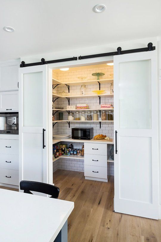 Look at the size of that pantry. And the double barn door treatment is fun.